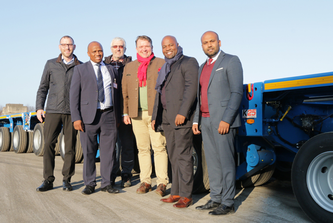 Rainer Sasse, Key Account Manager TII Sales, Wiseman Musekiwa, Head of Department Multi Axles/Lowbeds at Eskom Rotek Industries, Friedrich Messer, Head of Approval SCHEUERLE, Dr. Axel Müller, President TII Group, Sitsabo Kuhlase, General Manager Logistics Services at Eskom Rotek Industries and Ajanthas Kumarathas, Area Manager Sales after approval of the first vehicle lot.